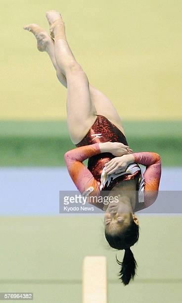 TOKYO Japan Koko Tsurumi flips during her balance beam routine at the allJapan gymnastics championships in Tokyo on April 24 2011 Tsurumi went on to...