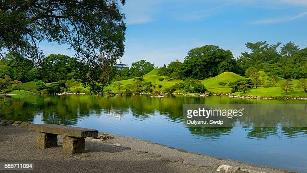 Japan, Kumamoto Prefecture, Suizenji Park, Reflection of trees in water