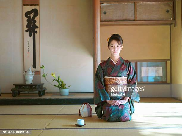Japan, Kyoto, Enko Temple, woman in kimono kneeling in temple, portrait