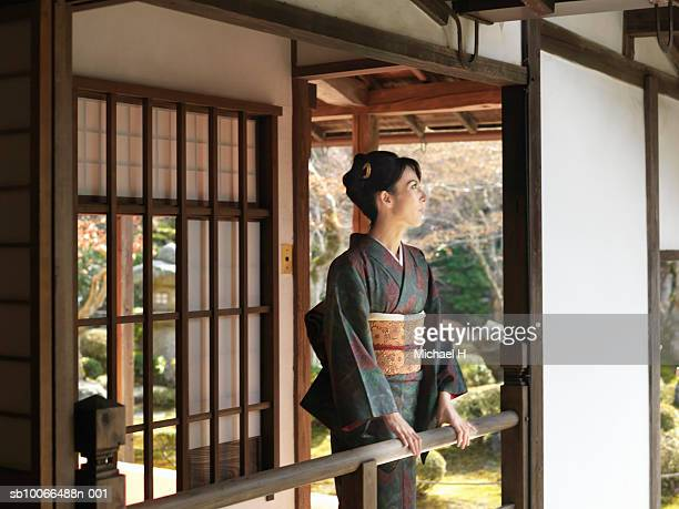 japan, kyoto, enko temple, woman in kimono standing on temple porch - obi sash stock pictures, royalty-free photos & images