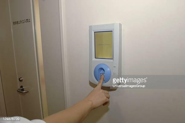 Japan Kyoto Japanese Red Cross Hospital nurse using fingerprint security system to enter ward