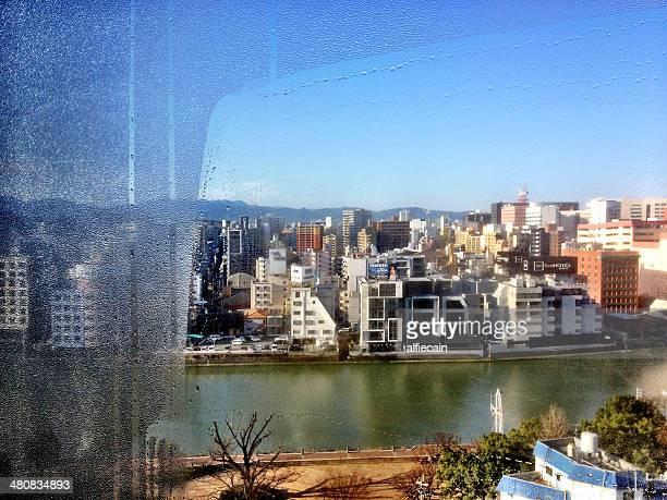 Japan, Kyushu Region, Fukoka Prefecture, View of Fukoka through condensed window