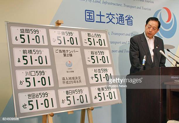 TOKYO Japan Land Infrastructure Transport and Tourism Minister Akihiro Ota announces new vehicle registration plates at the ministry in Tokyo on Aug...