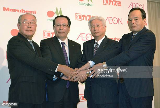 TOKYO Japan Leaders of the Aeon retail group Marubeni Corp and two food supermarket chains pose in Tokyo on May 19 after announcing their agreement...