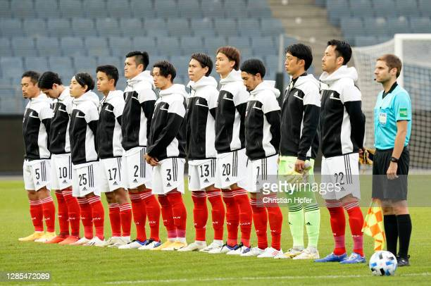 Japan line up for the anthems prior to the international friendly match between Japan and Panama at Merkur Arena on November 13, 2020 in Graz,...