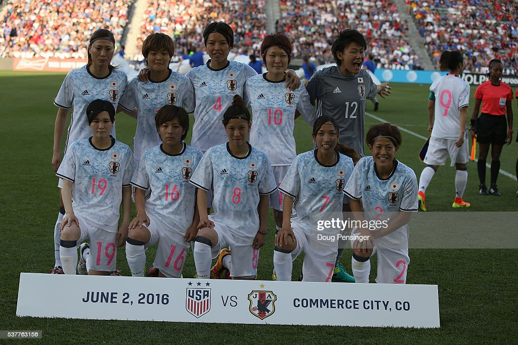 Japan looses the team captain Yuki Ogimi #9 of Japan to the coin toss as the team poses for a team photo prior to their match against the United States of America during an international friendly match at Dick's Sporting Goods Park on June 2, 2016 in Commerce City, Colorado. Japan and the United States played to a 3-3 draw.