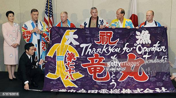 TOKYO Japan Lt Gen Burton Field the commander of US forces in Japan receives a fisherman's flag bearing messages from residents of Miyagi Prefecture...