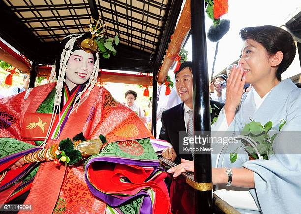 KYOTO Japan Maiko Nagase sitting in a portable shrine in traditional Japanese costume chats with her parents during the annual Aoi Matsuri in Kyoto...