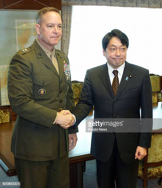 TOKYO Japan Maj Gen Andrew O'Donnell deputy commander of US Forces Japan and Japanese Defense Minister Itsunori Onodera shake hands at the Defense...