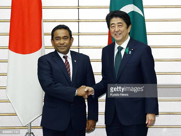 TOKYO Japan Maldives President Abdulla Yameen and Japanese Prime Minister Shinzo Abe shake hands before their meeting in Tokyo on April 15 2014