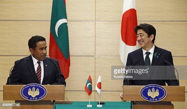 TOKYO Japan Maldives President Abdulla Yameen and Japanese Prime Minister Shinzo Abe hold a joint press conference in Tokyo on April 15 2014