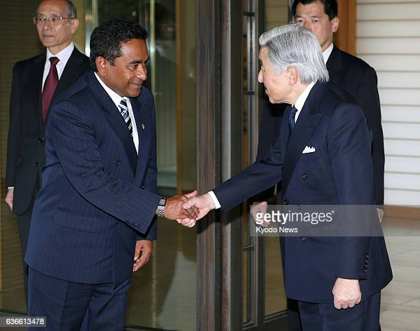 TOKYO Japan Maldives President Abdulla Yameen and Japan's Emperor Akihito shake hands after their meeting at the Imperial Palace in Tokyo on April 15...