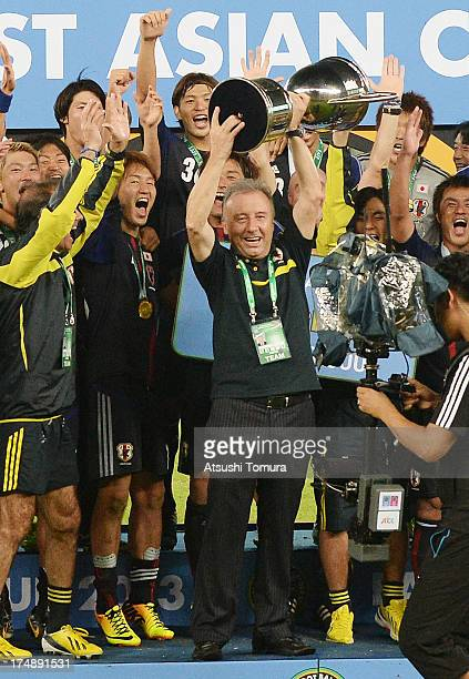 Japan manager Alberto Zaccheroni and players celebrate with the trophy after winning the EAFF East Asian Cup 2013 at Jamsil Stadium on July 28 2013...