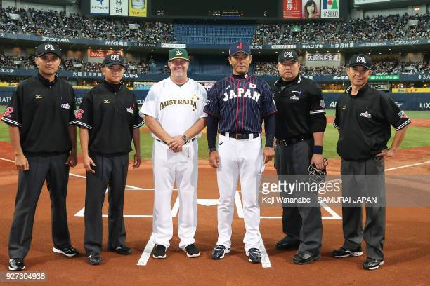 Japan Manager Atsunori Inaba and Australia Manager Steven Fish pose for photographs with umpires prior to the game two of the baseball international...