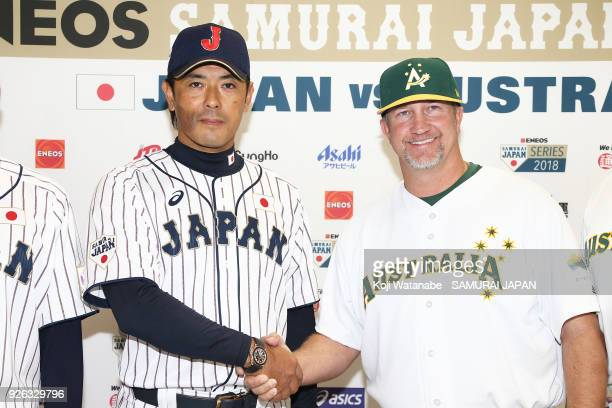 Japan Manager Atsunori Inaba and Australia Manager Steven Fish sake hand during a official press conference ahead of the baseball match between Japan...