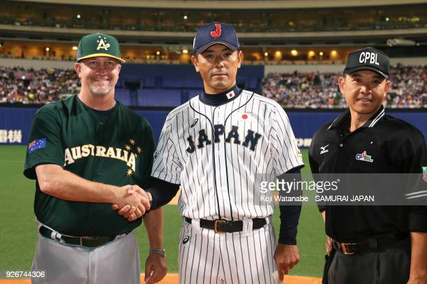 Japan Manager Atsunori Inaba and Australia Manager Steven Fish sakes hand during the game one of the baseball international match between Japan And...