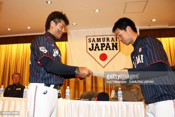 Japan Manager Atsunori Inaba and Shogo Akiyama meeting during a Japan training session at the Nagoya Dome on March 1 2018 in Nagoya Aichi Japan
