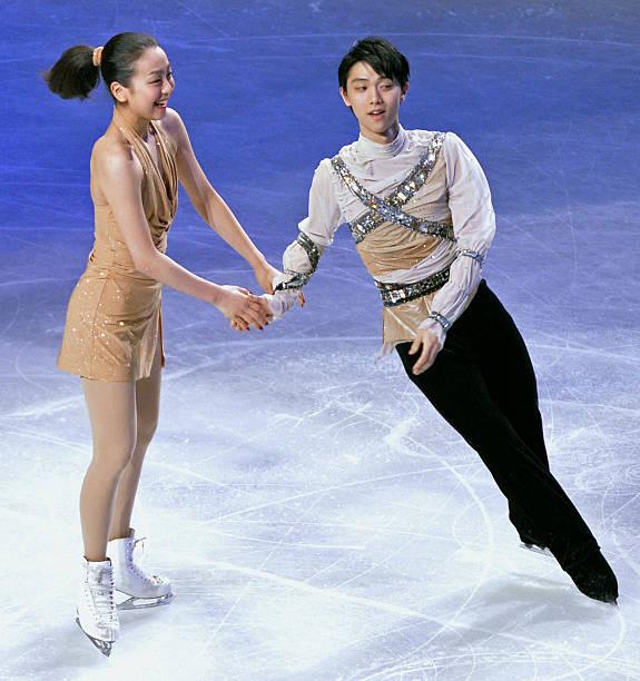 https://media.gettyimages.com/photos/japan-mao-asada-and-yuzuru-hanyu-of-japan-perform-during-the-at-the-picture-id636503092?k=6&m=636503092&s=612x612&w=0&h=B0zKOanGAN266Vero--dJn04ogdcct32c-RcLFdU1KM=