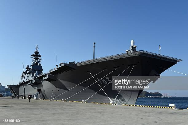 Japan Maritime Self Defense Forces latest helicopter destroyer Izumo anchors at its Yokosuka base in Yokosuka on March 31 2015 The JS Izumo with a...