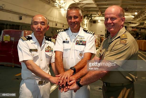 Japan Maritime Self-Defence Force Capt. Hideo Sasano, U.S. Navy Capt. Brian Shipman and Australian Army Lt. Col. John Cronin pose for photo following...