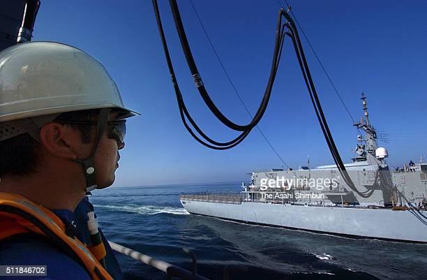 A Japan Maritime SelfDefense Force member operates on the refueling ship Tokiwa on March 10 2004 at Arabian Sea