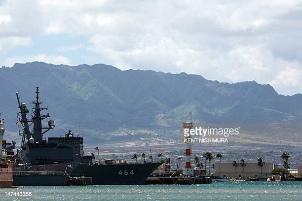 Japan Maritime SelfDefense Force ships JS Bungo sits pier side with the Wainae Mountain Range as a backdrop at Joint Base Pearl HarborHickam in...