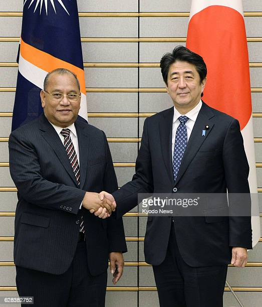 TOKYO Japan Marshall Islands President Christopher Loeak and Japanese Prime Minister Shinzo Abe shake hands before talking in Tokyo on Feb 14 2014