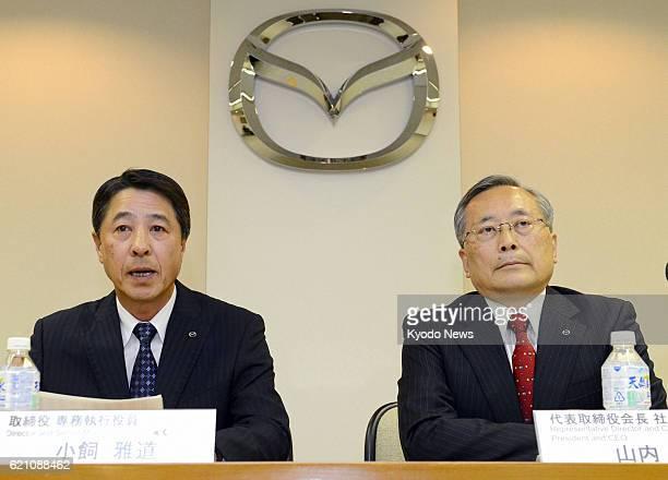HIROSHIMA Japan Masamichi Kogai senior managing executive officer of Mazda Motor Corp and Takashi Yamanouchi chairman and president of the company...