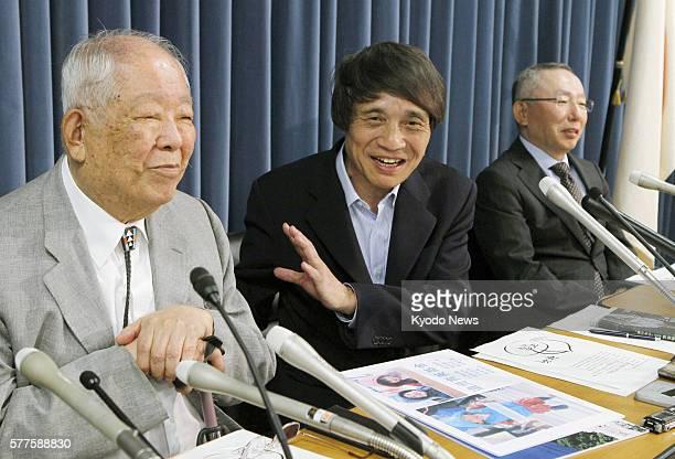 TOKYO Japan Masatoshi Koshiba a recipient of the Nobel Prize in Physics architect Tadao Ando and Fast Retailing Co President Tadashi Yanai attend a...
