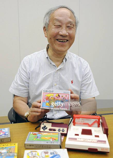 KYOTO Japan Masayuki Uemura adviser for Nintendo Co who developed 'Famicom' or the Family Computer video game console holds 'Donkey Kong' software...
