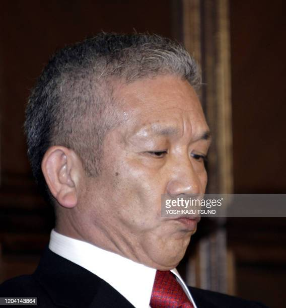 Japan McDonald's Hamburger chain president Eiko Harada shows a sour face at a press conference after he announced the comapny's franchise shops has...
