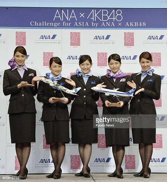 Japan - Members of all-girl pop group AKB48, Sayaka Akimoto, Rina Kawaei, Mayu Watanabe and Yui Yokoyama, and Mariya Suzuki, who has been transferred...