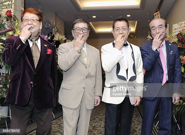 TOKYO Japan Members of the Drifters Takagi Boo Nakamoto Koji Kato Cha and Shimura Ken pose for photos with Kato's trademark gesture at a hotel in...