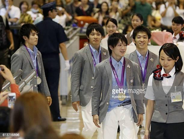NARITA Japan Members of the Japan men's gymnastics team Ryohei Kato Yusuke Tanaka Kohei Uchimura and Kazuhito Tanaka arrive at Narita International...