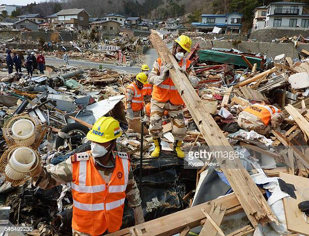 ONAGAWA Japan Members of the National Disaster Response Force from India search through the rubble for missing people in the town of Onagawa Miyagi...