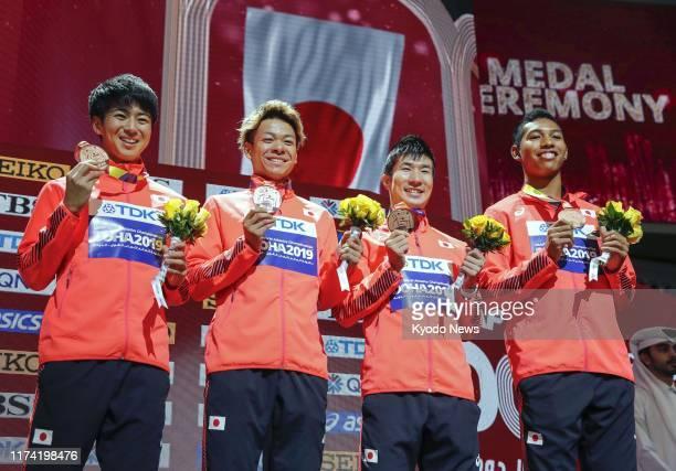 Japan men's 4x100-meter relay team of Shuhei Tada, Kirara Shiraishi, Yoshihide Kiryu and Abdul Hakim Sani Brown celebrate at the medal ceremony on...