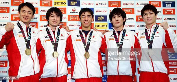 Japan Men's Gymnastics team members Yusuke Tanaka Kohei Uchimura Kenzo Shirai Ryohei Kato and Naoto Hayasaka pose for photographs during a press...