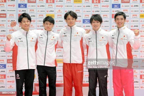 Japan Men's team members for the Wold Championships Kazuma Kaya Wataru Tanigawa Yusuke Tanaka Kohei Uchimura and Kenzo Shirai pose for photographs...