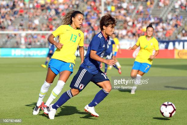 Japan midfielder Rika Masuya pursued by Brazil defender Rilany during a friendly match between Japan and Brazil on July 29 at Pratt Whitney Stadium...