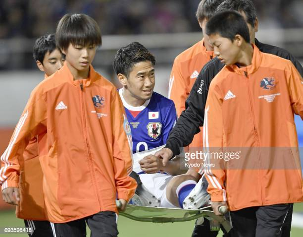 Japan midfielder Shinji Kagawa is carried off the pitch on a stretcher during the first half of a 11 draw with Syria in a friendly at Ajinomoto...