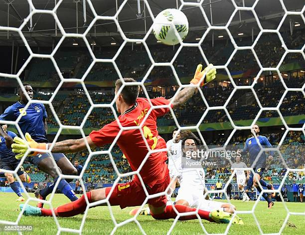 Japan midfielder Shinya Yajima scores a goal past Sweden goalkeeper Andreas Linde in the second half of their final group match of the men's soccer...