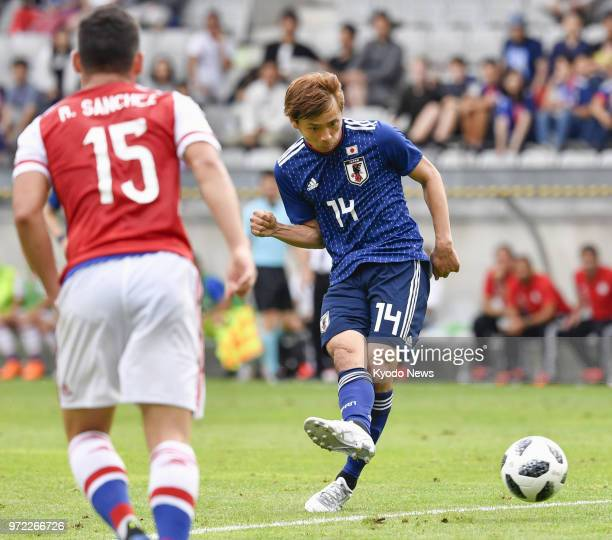 Japan midfielder Takashi Inui near Paraguay midfielder Richard Sanchez scores a goal in the second half of a friendly in Innsbruck Austria on June 12...