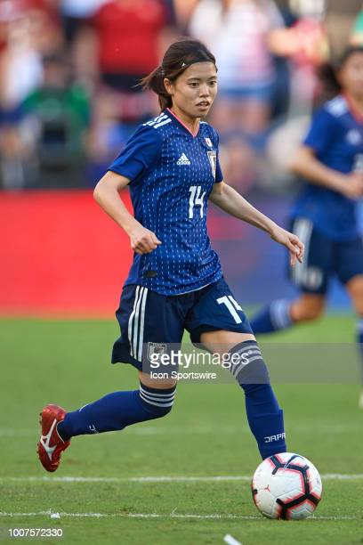 Japan midfielder Yui Hasegawa dribbles the ball in game action during a Tournament of Nations match between the United States and Japan on July 26...