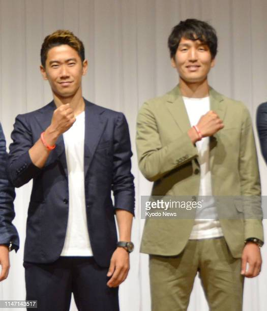 Japan midfielders Shinji Kagawa and Genki Haraguchi who play for Turkey's Besiktas and Germany's Hannover respectively pose for a photo in Tokyo on...