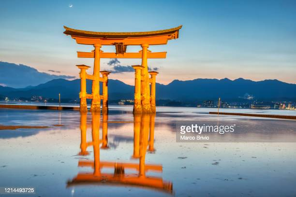 japan miyajima. floating torii gate - marco brivio stock pictures, royalty-free photos & images