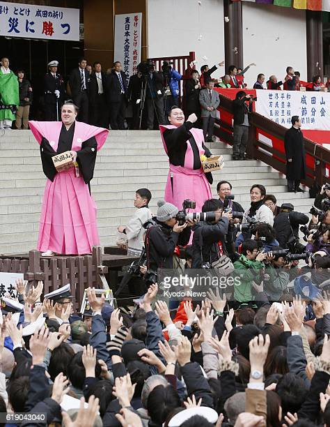 NARITA Japan Mongolian grand champion Hakuho and Estonian sekiwake Baruto throw bags of beans during the annual beanthrowing festival marking the...
