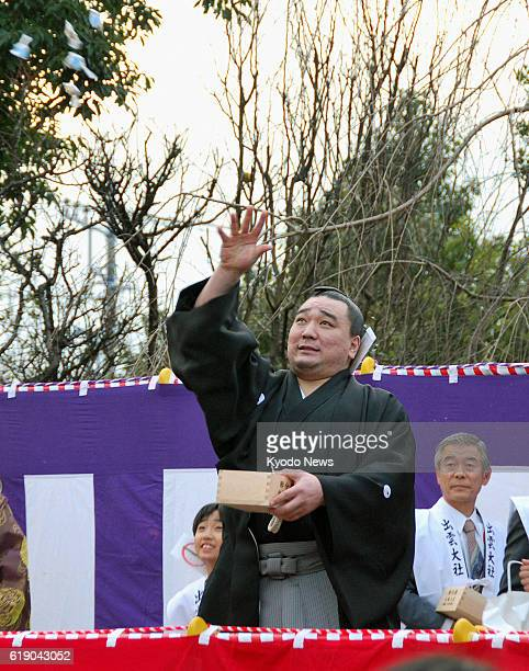 HADANO Japan Mongolian grand champion Harumafuji throws bags of beans during the annual beanthrowing festival marking the start of spring according...