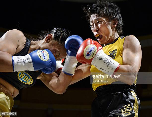 OSAKA Japan Nao Ikeyama of Japan delivers a punch to Jessebelle Pagaduan of the Philippines in the second round of their WBO women's atomweight world...