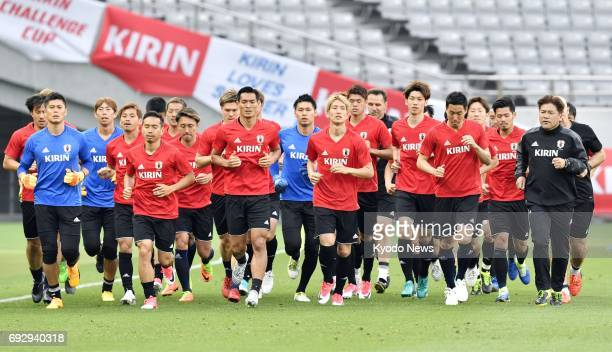 Japan national soccer team players work out during a practice session in Chofu Tokyo on June 6 ahead of a friendly match against Syria the next day...
