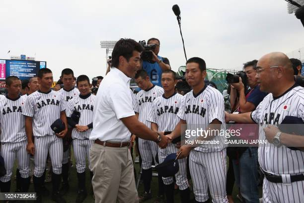 Japan national team head coach Atsunori Inaba shakes hands with captain Takuya Nakagawa of Samurai Japan U18 prior to the game between Samurai Japan...